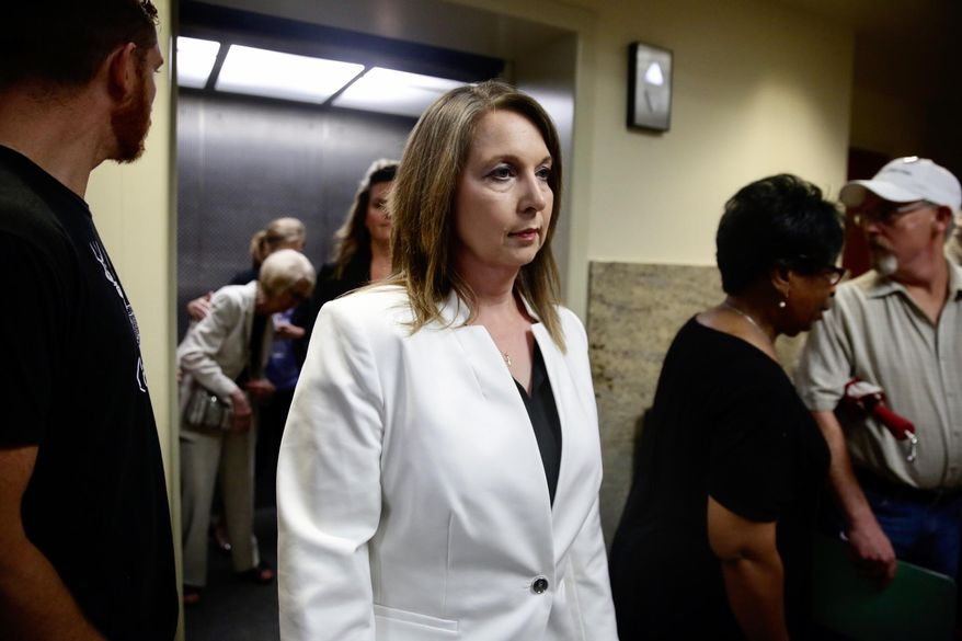 Tulsa Police officer Betty Shelby arrives at the Tulsa County Courthouse Thursday, May 11, 2017, for her manslaughter trial in the shooting death of Terence Crutcher, in Tulsa, Okla. (Mike Simons/Tulsa World via AP)