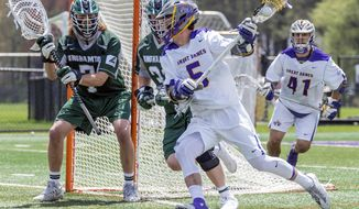 In this May 6, 2017, photo provided by University of Albany, University of Albany's Connor Fields (5) prepares to take a shot against University of Binghamton  goalkeeper Tanner Cosens (7) during the America east Conference Championship in Albany, N.Y. Fields leads the nation in scoring with 108 points on a well-balanced team that averages 15.8 goals per game. (Bill Ziskin/University of Albany via AP)