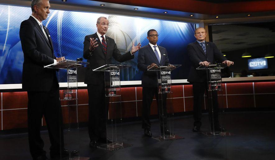 Candidates, from left, Assemblyman John Wisniewski, Phil Murphy, Jim Johnson and Sen. Ray Lesniak attend a Democratic gubernatorial primary debate, Thursday, May 11, 2017, in Newark, N.J. (AP Photo/Julio Cortez, Pool)