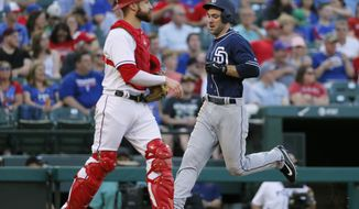 San Diego Padres' Matt Szczur, right, scores on Ryan Schimpf's single as Texas Rangers catcher Jonathan Lucroy (25) waits for a throw during the first inning of a baseball game, Thursday, May 11, 2017, in Arlington, Texas. (AP Photo/Tony Gutierrez)