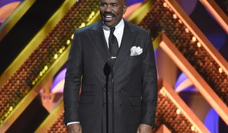 """FILE - In this April 26, 2015 file photo, Steve Harvey presents an award at the 42nd annual Daytime Emmy Awards in Burbank, Calif. Before the start of this season of """"The Steve Harvey Show.,"""" Harvey emailed his staff requesting that they not approach him in the makeup chair or """"ambush"""" him in a hallway. Since being made public, the memo has sparked scorn and jeering on personal media. (Photo by Chris Pizzello/Invision/AP, File)"""