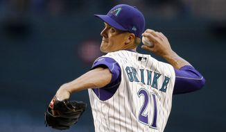 Arizona Diamondbacks' Zack Greinke throws a pitch against the Pittsburgh Pirates during the first inning of a baseball game Thursday, May 11, 2017, in Phoenix. (AP Photo/Ross D. Franklin)