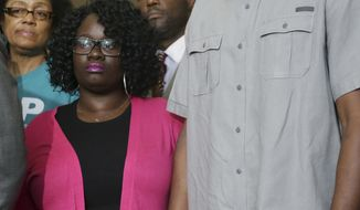 Jordan Edwards' parents Charmaine Edwards, left, and Odell Edwards stand during for a news conference in Dallas, Thursday, May 11, 2017. The U.S. Justice Department has begun an investigation prompted by the fatal shooting of Jordan Edwards, a black 15-year-old boy, by Roy Oliver, a white suburban Dallas police officer. (AP Photo/LM Otero)