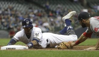 Milwaukee Brewers' Keon Broxton slides safely back to first as Boston Red Sox first baseman Mitch Moreland is late with the tag during the sixth inning of a baseball game Wednesday, May 10, 2017, in Milwaukee. (AP Photo/Morry Gash)