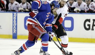 New York Rangers' Mats Zuccarello (36) and Ottawa Senators' Zack Smith (15) fights for control of the puck during the first period of Game 6 of an NHL hockey Stanley Cup second-round playoff series, Tuesday, May 9, 2017, in New York. (AP Photo/Frank Franklin II)