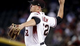 Arizona Diamondbacks pitcher Zack Godley throws against the Detroit Tigers during the sixth inning of a baseball game, Wednesday, May 10, 2017, in Phoenix. (AP Photo/Matt York)