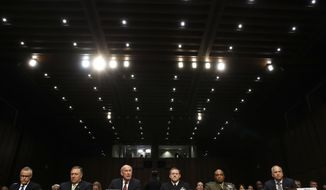 From left, acting FBI Director Andrew McCabe, CIA Director Mike Pompeo, Director of National Intelligence Dan Coats, National Security Agency Director Adm. Michael Rogers, Defense Intelligence Agency Director Lt. Gen. Vincent Stewart, and National Geospatial-Intelligence Agency (NGA) Director Robert Cardillo, prepare to testify on Capitol Hill in Washington, Thursday, May 11, 2017, before the Senate Intelligence Committee hearing on major threats facing the U.S. (AP Photo/Jacquelyn Martin)