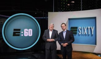 """In this May 3, 2017 image released by ESPN, co-hosts Bob Ley, left, and Jeremy Schaap appear on the set of the revamped Sunday magazine series, """"E:60,"""" in Bristol, Conn. The first new """"E:60,"""" featuring a story about the Syrian national soccer team, airs Sunday at 9 a.m. ET. (Joe Faraoni/ESPN via AP)"""