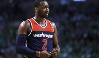 Washington Wizards guard John Wall reacts after a foul during the second quarter in Game 5 of the team's second-round NBA basketball playoff series against the Boston Celtics in Boston, Wednesday, May 10, 2017. The Celtics won 123-101. (AP Photo/Charles Krupa)