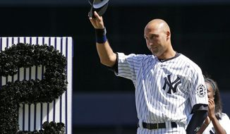 FILE - In this Sept. 7, 2014, file photo, New York Yankees' Derek Jeter (2) tips his cap to fans during a pregame ceremony honoring the Yankees captain. Jeter wrote an essay published May 11, 2017, on his Players' Tribune site thanking the city before his No. 2 jersey is permanently retired by the team on May 14. (AP Photo/Kathy Willens, File)