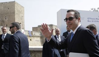 U.S. Secretary of the Treasury Steven Mnuchin arrives for the opening session of the G-7 of Finance ministers in Bari, southern Italy, Friday, May 12, 2017. (AP Photo/Andrew Medichini)