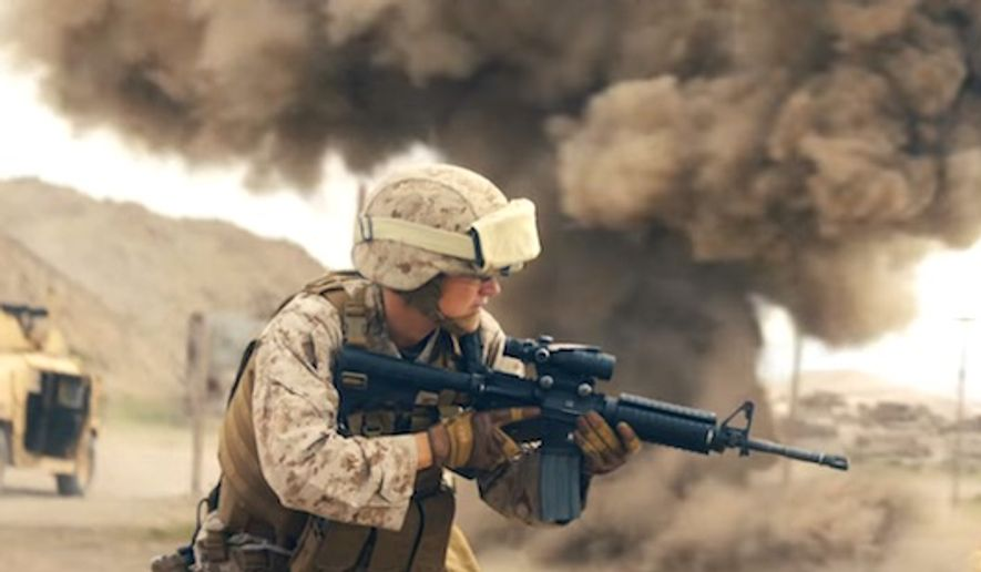 A new ad by the U.S. Marine Corps makes a specific point to highlight women in combat, whereas past commercials featured them in training environments. (YouTube, Marine Corps) ** FILE **