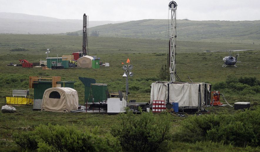 In this July 13, 2007 file photo, workers with the Pebble Mine project test drill in the Bristol Bay region of Alaska near the village of Iliamma. (AP Photo/Al Grillo, File) **FILE**