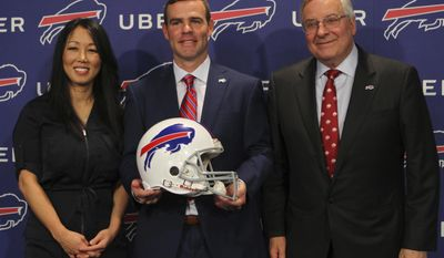 Buffalo Bills owners Kim and Terry Pegula welcome new General Manager Brandon Beane, center, during an NFL football press conference, Friday, May 12, 2017, in Orchard Park, N.Y. (AP Photo/Jeffrey T. Barnes)