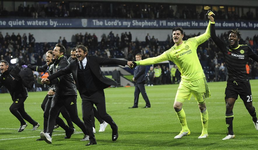 Chelsea's manager Antonio Conte, centre, celebrates with players after the English Premier League soccer match between West Bromwich Albion and Chelsea, at the Hawthorns in West Bromwich, England, Friday, May 12, 2017. Chelsea won the match 0-1 meaning they win the Premier League title. (AP Photo/Rui Vieira)