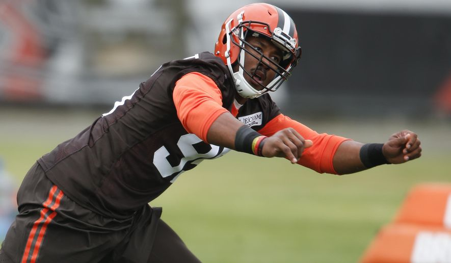 Cleveland Browns' Myles Garrett runs through drills during an NFL football rookie minicamp, Friday, May 12, 2017, in Berea, Ohio. (AP Photo/Ron Schwane)
