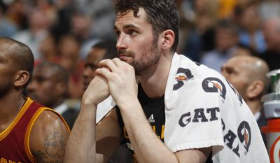FILE - In this March 22, 2017, file photo, Cleveland Cavaliers forward Kevin Love sits on the bench as time runs out in the second half of an NBA basketball game against the Denver Nuggets, in Denver. As the Cavs continue to wait for the winner of the Boston-Washington series to emerge as their opponent in the Eastern Conference finals, Love's reduced role in his third postseason for Cleveland has become a topic for discussion. And while the All-Star forward has found himself at the center of previous controversies during his time with the Cavs, there are no hidden meanings or subliminal messages at work. (AP Photo/David Zalubowski, FIle)