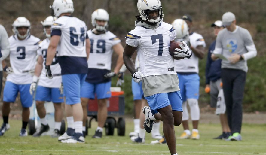 San Diego Chargers rookie Mike Williams runs with the ball during an NFL football rookie minicamp Friday, May 12, 2017, in San Diego. (AP Photo/Chris Carlson)
