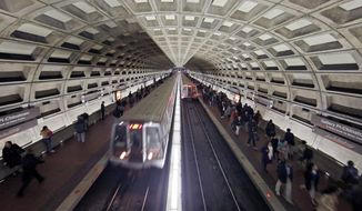 In this March 15, 2016 file photo, Metro trains arrive in the Gallery Place-Chinatown Metro station in Washington.  (AP Photo/Alex Brandon, File) **FILE**