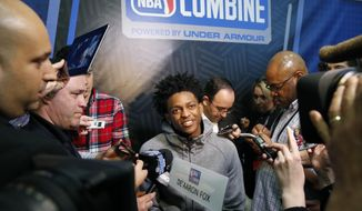 De'Aaron Fox, center, from Kentucky, listens to a question at the NBA draft basketball combine Friday, May 12, 2017, in Chicago. (AP Photo/Charles Rex Arbogast)