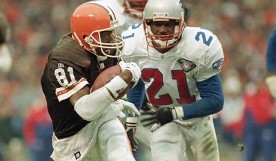 FILE - In this Jan, 1, 1995, file photo, Cleveland Browns' wide receiver Michael Jackson (81) runs away from New England Patriots cornerback Ricky Reynolds (21) with an 18-yard pass reception in the second quarter of the AFC playoff NFL football game in Cleveland. An early morning accident Friday, May 12, 2017, has claimed the lives of two people, including former NFL player Michael Jackson who, after retiring from football, also served as mayor of a Louisiana village.(AP Photo/Jeff Glidden, File)