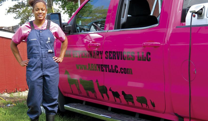 In this Friday, ay 5, 2017 photo, Dr. Sarah Blackwell, of Ark Veterinary Services, a large-animal veterinarian, who services parts of South Carolina and North Carolina, poses in front of her truck, in Dalzell, S.C. (Jessica Stephens /The Item via AP)