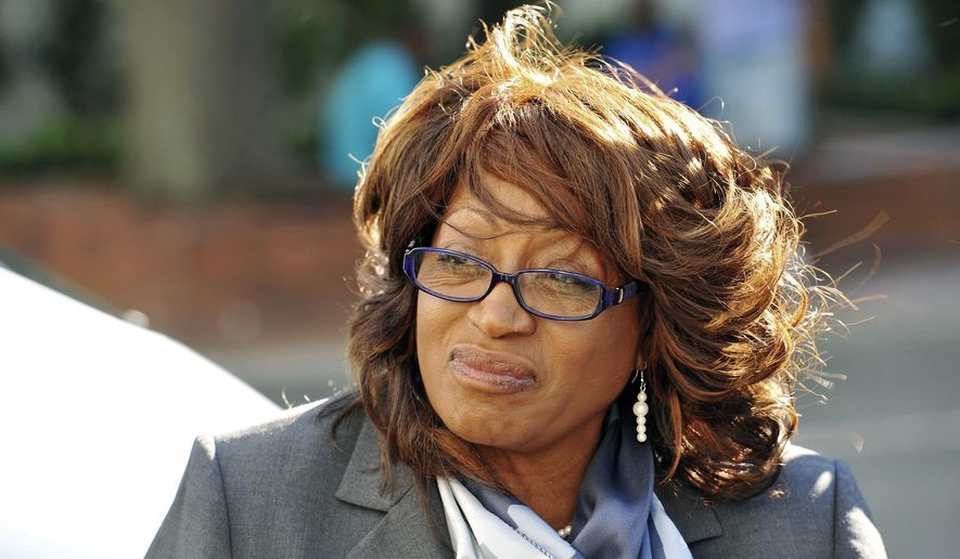 FILE- In this May 5, 2017 file photo, former U.S. Rep. Corrine Brown walks to the federal courthouse in Jacksonville, Fla. Brown was found guilty on Thursday, May 11, 2017, of taking money from a charity that was purported to be giving scholarships to poor students. (Bob Self/The Florida Times-Union via AP, File)