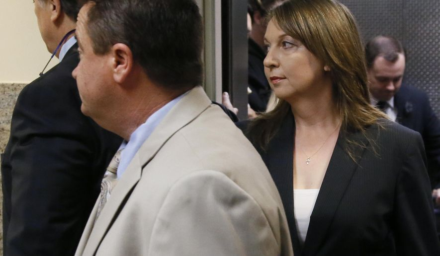 Tulsa police officer Betty Jo Shelby, right, arrives with her husband, Dave Shelby, left, for her trial in Tulsa, Okla., Friday, May 12, 2017. She is charged with manslaughter in the shooting of Terence Crutcher, an unarmed black man. (AP Photo/Sue Ogrocki)