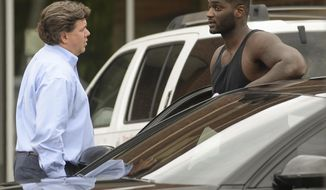 Former Alabama and NFL football player Rolando McClain talks with his lawyer, Carl Cole, after exiting the Morgan County Jail in Decatur, Ala. on Friday, May 12, 2017. Earlier in the day, McClain was arrested in Hartselle, Ala., on equipment violations, firearm and drug charges, according to the Hartselle Police Department.(Crystal Vander Weit/The Decatur Daily via AP)
