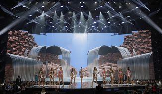 In this May 11, 2017, photo, People including Miss North Dakota USA Raquel Wellentin, center right, compete during a preliminary competition for Miss USA in Las Vegas. Wellentin emigrated from the Philippines. Five of the contestants vying for the Miss USA title this year were born in other countries and now U.S. citizens. (AP Photo/John Locher)