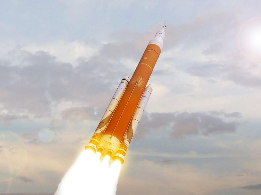 This undated image made available by NASA shows an artist's rendering of the Space Launch System. Still in development, the super-sized rocket is meant to eventually send astronauts to Mars. On Friday, May 12, 2017, NASA said its 2019 test flight will fly without a crew. (NASA via AP)
