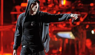 FILE - In this April 15, 2012, file photo, Eminem performs at the 2012 Coachella Valley Music and Arts Festival in Indio, Calif.  A two-week trial that ended Friday, May 12, 2017, at the High Court in Wellington in the case in which music publishers for Eminem are suing New Zealand's ruling conservative political party for copyright infringement. The judge may not rule for months.  (AP Photo/Chris Pizzello, File)