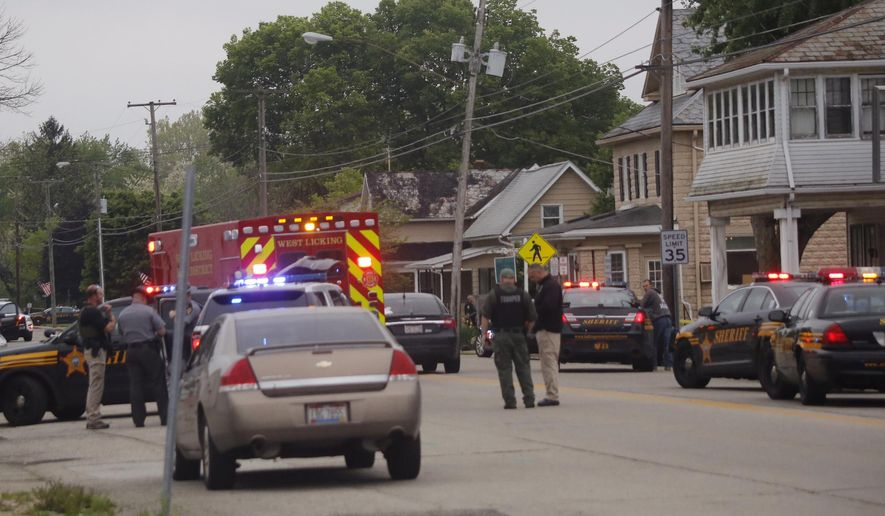 Emergency personnel arrive to the scene of a shooting outside Pine Kirk nursing home in Kirkersville, Ohio on Friday, May 12, 2017.  Authorities say Steven Eric Disario, who headed the Kirkersville Police Department, and two nursing home employees have been killed by a gunman who was later found dead inside the care facility.   (Tom Dodge/The Columbus Dispatch via AP)