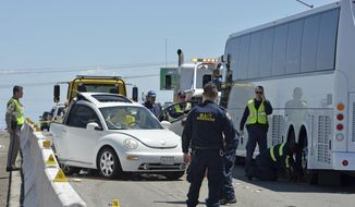 The California Highway Patrol investigate the scene on east-bound I-580 where an off-duty Alameda County Sheriff's deputy was killed after a collision involving a bus carrying Tesla employees near Tracy, Calif., Friday, May, 12, 2017.Alameda County Sheriff Gregory Ahern says Deputy Sroeuy Khin was killed Friday after working a 12-hour shift at San Rita Jail and a day before his 51st birthday. (Doug Duran/East Bay Times via AP)