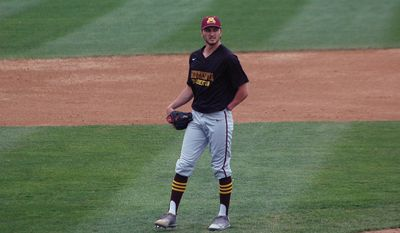 University of Minnesota-Crookston pitcher Parker Hanson stands off the mound between pitches during a college baseball game against Minnesota State in St. Cloud, Minn., Wednesday, May 10, 2017. Hanson's success could be measured in his 90-mph fastball, his nasty slider or his start that vaulted his college baseball team into the playoffs. Or it could be marked by what he's missing. Hanson was born without a left hand, but found a way to adapt at a young age so he could pitch, field, bat and play the game he loved. (AP Photo/Jeff Baenen)