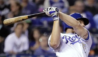 Kansas City Royals' Brandon Moss swings for a solo home run during the fifth inning of a baseball game against the Baltimore Orioles Friday, May 12, 2017, in Kansas City, Mo. (AP Photo/Charlie Riedel)