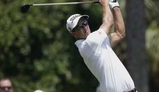 Adam Scott, of Australia, hits from the second tee during the first round of The Players Championship golf tournament Thursday, May 11, 2017, in Ponte Vedra Beach, Fla. (AP Photo/Lynne Sladky)