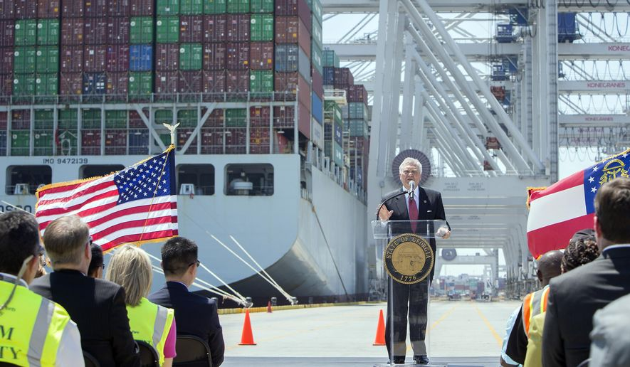 In this photo provided by the Georgia Port Authority, Georgia Gov. Nathan Deal speaks in front of the container ship COSCO Development at the Port of Savannah, Friday, May 12, 2017, in Garden City, Ga. The ship is the largest vessel ever to call on the U.S. East Coast. (AP Photo/Georgia Port Authority, Stephen Morton)