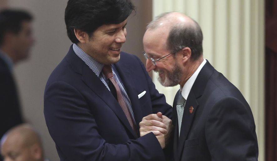 FILE - In this Sept. 8, 2015, file photo, Senate President Pro Tem Kevin de Leon, D-Los Angeles, left, congratulates Sen. Steve Glazer, D-Orinda, after the Senate approved his bill SB539, banning schools, parks and public property from being named after Confederate leaders in Sacramento, Calif. he only Democratic state senator to vote against a California gas and vehicle tax increase is losing his powerful post as a committee chairman. Sen. Steve Glazer of Orinda said Friday, May 12, 2017, that de Leon asked him to step down as chairman of the Governmental Organization committee. (AP Photo/Rich Pedroncelli, File)