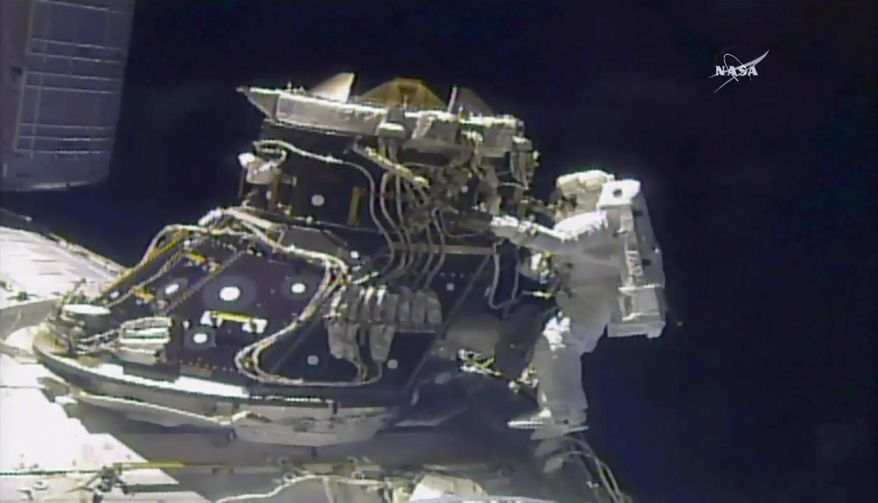 In this image made from video provided by NASA, astronaut Jack Fischer works outside the International Space Station on Friday, May 12, 2017. Fischer and Peggy Whitson, not pictured, performed the station's 200th spacewalk. (NASA via AP)