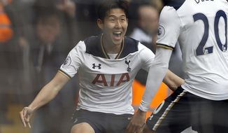 FILE - In this Saturday, April 15, 2017 file photo, Tottenham Hotspur's Son Heung-min celebrates scoring during the English Premier League soccer match against Bournemouth at White Hart Lane stadium in London. Son Heung-min has won the Premier League's player of the month award, becoming the only two-time recipient so far this season. (AP Photo/Frank Augstein, File)