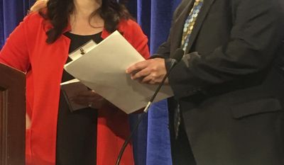 Republican National Committee Chairwoman Ronna Romney McDaniel, left, speaks with Bob Paduchik, party co-chairman of the Republican National Committee, at the spring meeting in Coronado, Calif., Friday, May 12, 2017. While Trump's abrupt firing of FBI Director James Comey roiled Washington, Republicans who attended the national committee's spring meeting outside San Diego this week defended the president's actions and insisted that it would have little political impact on midterm elections next year. (AP Photo/Elliot Spagat)