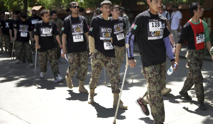 """Wounded warriors from Afghanistan's National Security Forces arrive at the Resolute Support Headquarters to participate in """"Invictus Games"""", in Kabul, Afghanistan, Saturday, May 13 , 2017. Wounded warriors from Afghanistan's National Security Forces are competing for a spot in the Invictus Games to be held in Canada in September. (AP Photos/Massoud Hossaini)"""