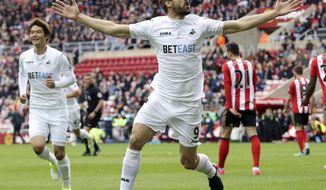 Swansea City's Fernando Llorente celebrates scoring his side's first goal of the game,  during the English Premier League soccer match between Sunderland and Swansea City, at the Stadium of Light, in Sunderland, England, Saturday May 13, 2017. (Owen Humphreys/PA via AP)