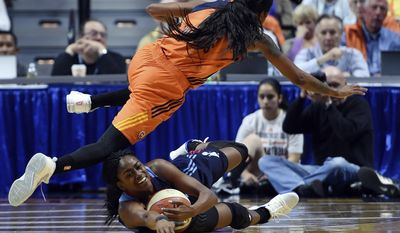 Connecticut Sun's Courtney Williams, top, fouls Atlanta Dream's Tiffany Hayes during the first half of a WNBA basketball game Saturday, May 13, 2017, in Uncasville, Conn. (Sean D. Elliot/The Day via AP)