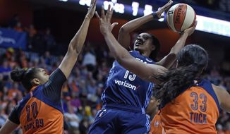 Atlanta Dream's Tiffany Hayes (15) shoots over Connecticut Sun's Alex Bentley (20) and Morgan Tuck in the first half during a WNBA basketball game Saturday, May 13, 2017, in Uncasville, Conn. (Sean D. Elliot/The Day via AP)