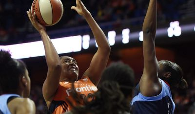 Connecticut Sun's Morgan Tuck shoots over Atlanta Dream's Elizabeth Williams during a WNBA basketball game Saturday, May 13, 2017, in Uncasville, Conn. (Sean D. Elliot/The Day via AP)