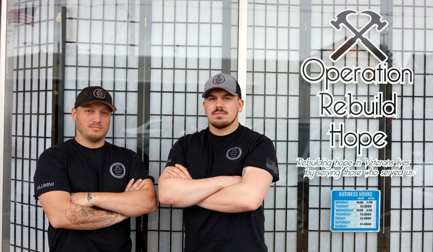 "In this April 7, 2017 photo, Patrick Wright, 38, left, stands with Kyle Brown, 26, in front of Operation Rebuild Hope's office in North Bend, Ore. The two U.S. Marine veterans' nonprofit aims to assist veterans with construction projects and by making services more easily accessible. They say they hope to begin building a small community of ""micro"" homes somewhere within North Bend or Coos Bay city limits over the next few years. (Spencer Cole/The World via AP)"