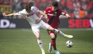Leverkusen's Kai Havertz , right, and Cologne's  Dominique Heintz challenge for the ball during a German Bundesliga soccer match between Bayer Leverkusen and 1. FC Cologne in Leverkusen, Germany, Saturday, May 13, 2017.  (Marius Becker/dpa via AP)