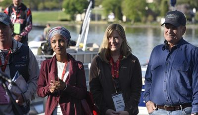 Ilhan Omar, left, and Melissa Hortman of the Minnesota House of Representatives stand with Gov. Mark Dayton at the start of the 2017 Governor's Fishing Opener Saturday, April 13, 2017, at Wilson Park on the Mississippi River in St. Cloud, Minn. (Dave Schwarz/The St. Cloud Times via AP)